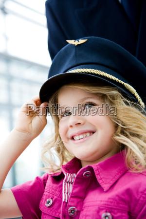 girl wearing flight captains hat