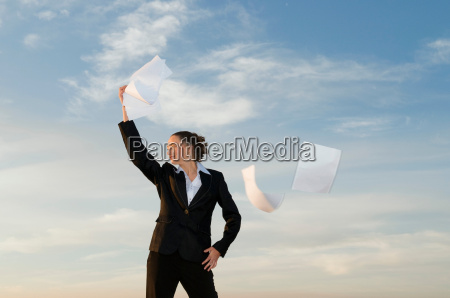 businesswoman shot against the sky