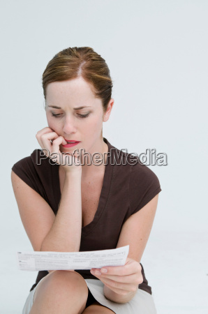 a worried woman looking at a