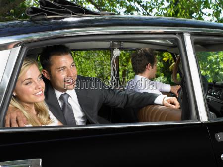 wedding couple in car