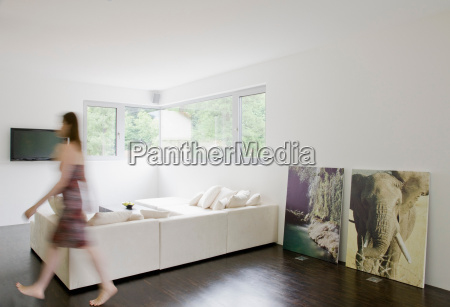 woman walking across living room