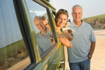 mature couple with vintage camper van