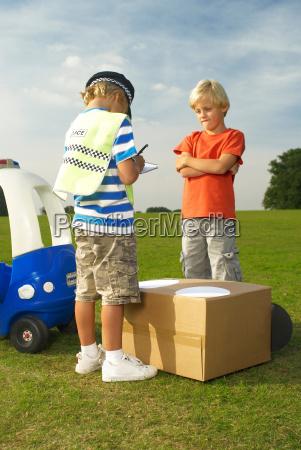 boy policeman booking boy driver