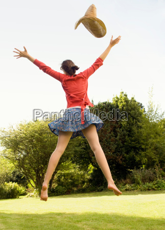 female jumping in the air