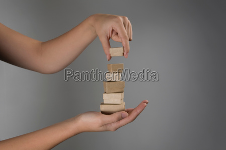 female hands holding pile of small
