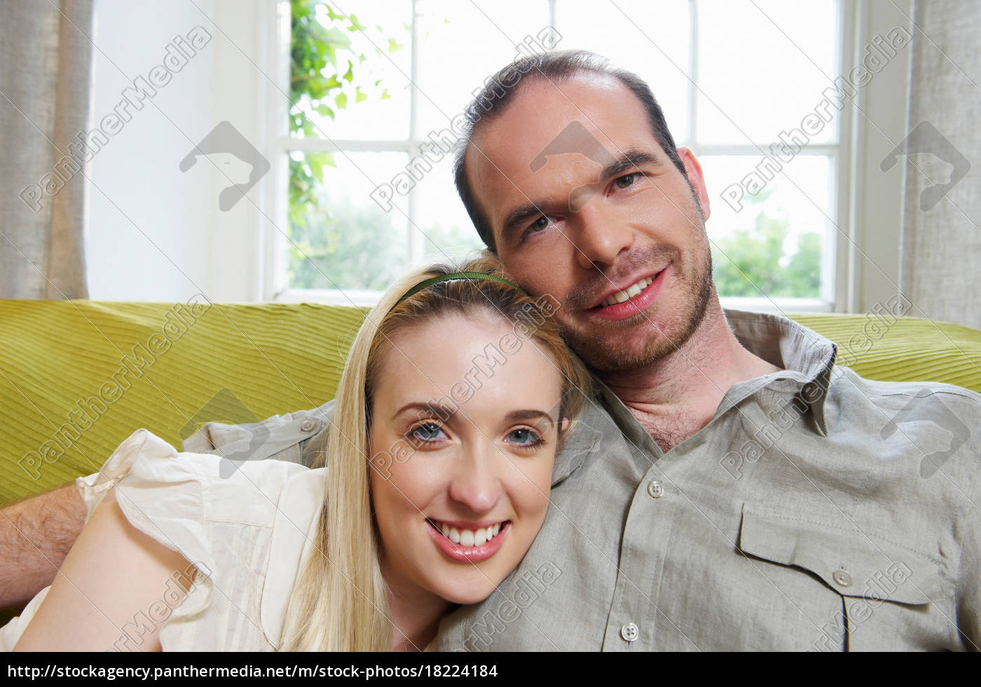 couple, sitting, on, couch, , smiling - 18224184