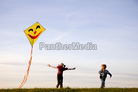 girl and boy fly a kite