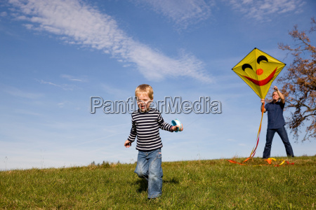 boy and father start a kite