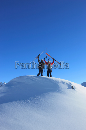skiers on top of mountain