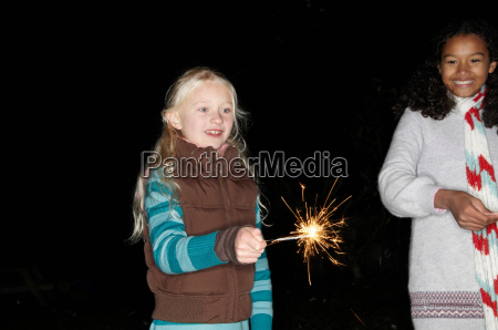 two young girls with sparklers