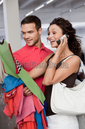 couple shopping looking at dresses