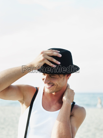 man wearing hat at beach