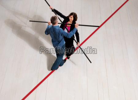 man and woman balancing on thin