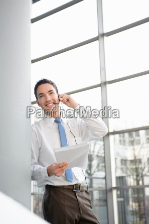 smiling business man in office headset