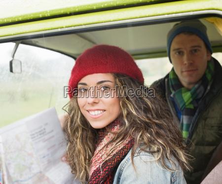 couple in camper van looking at