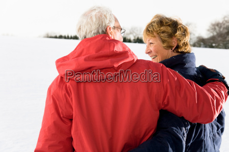 senior couple in the snow