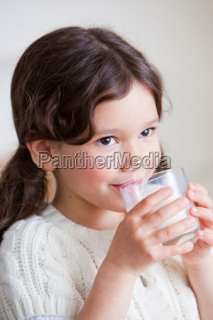 beautiful young girl drinking milk