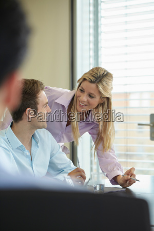 two business colleagues discussing work