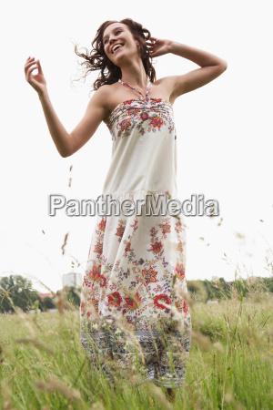 woman dancing in wild meadow