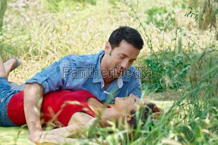 romantic couple lying in long grass