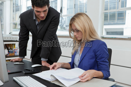 colleagues reviewing a business plan
