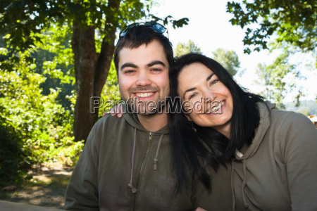 couple hugging for camera