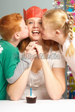 mum being kissed by her children
