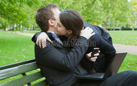 man and woman greeting in park