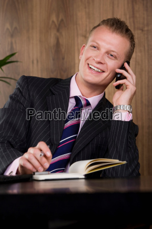 business man at desk on phone