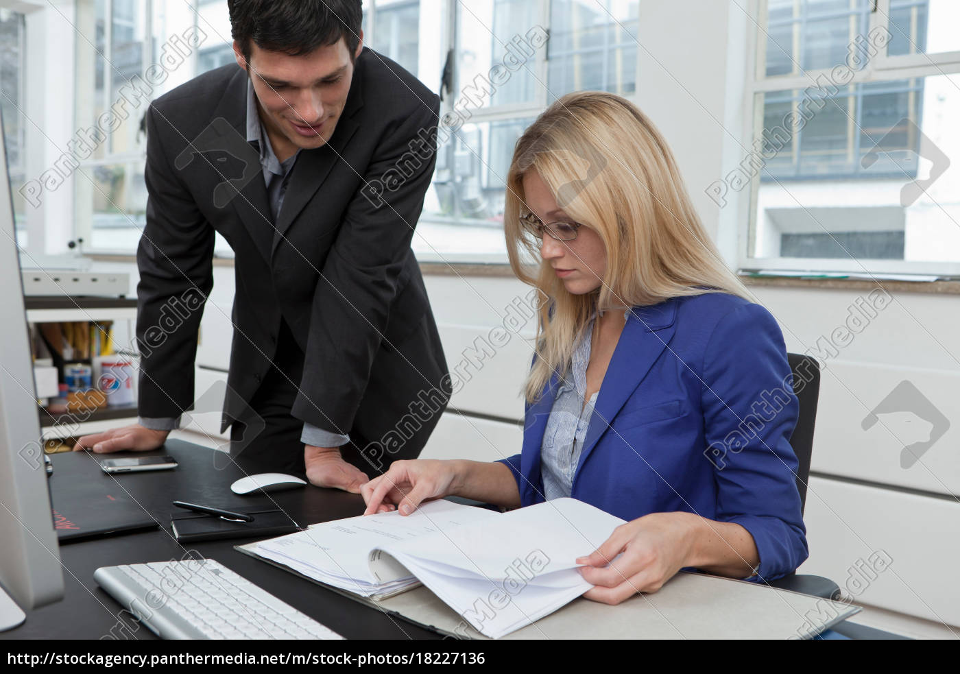 colleagues, reviewing, a, business, plan - 18227136
