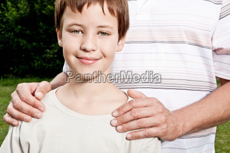 fathers hands on sons shoulders