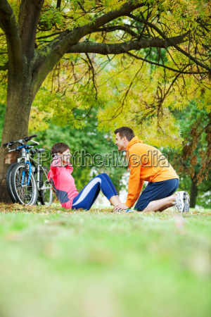 man and woman exercising in the