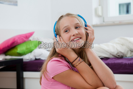 smiling girl listening to headphones