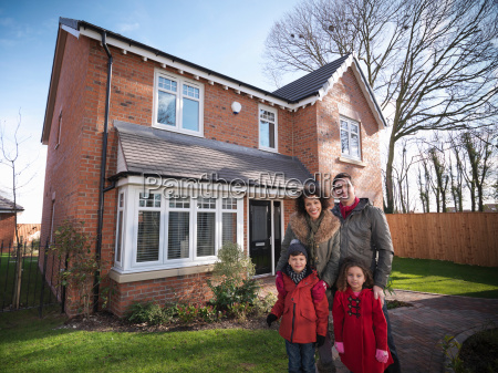 family standing outside of energy efficient