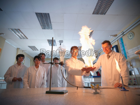 science teacher and students conducting experiment