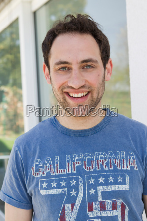 smiling man standing outdoors