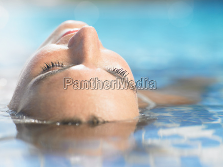 a woman floating in hotel pool