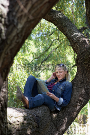 woman sitting in a tree on