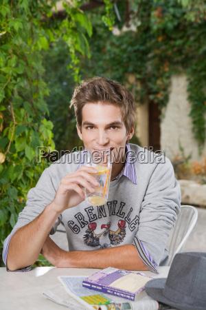 man drinking soft beverage