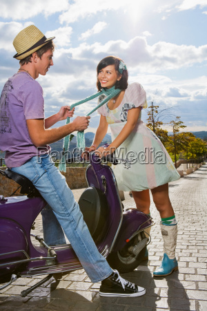 woman flirting with man on scooter