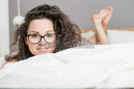 mid adult woman lying on front