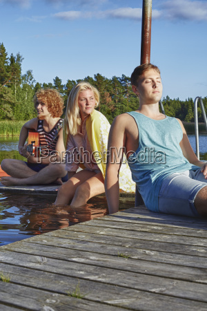 three young adult friends relaxing on