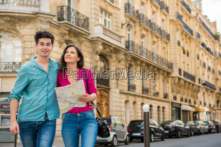 young couple with map paris france