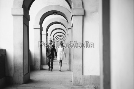couple walking hand in hand through