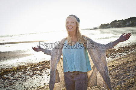 smiling young woman on bournemouth beach