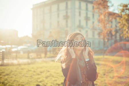 mid adult woman listening to headphones