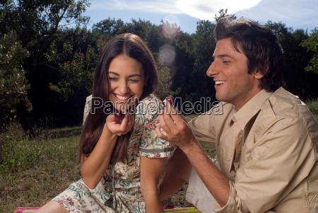 young couple sharing fresh fruit