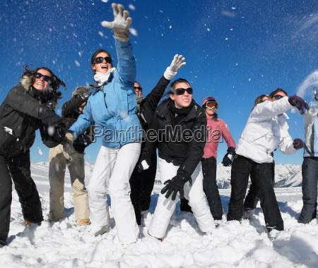 group throwing snowballs