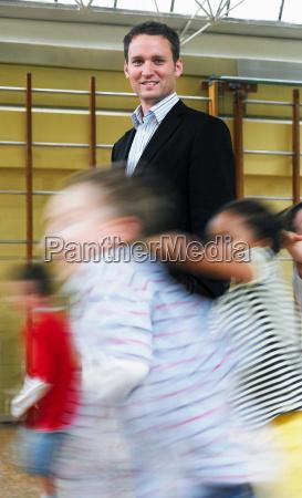 male teacher standing in gymnasium