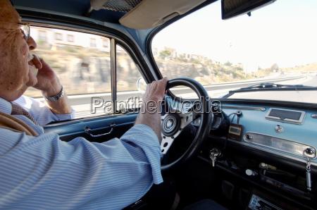 senior adult man driving car